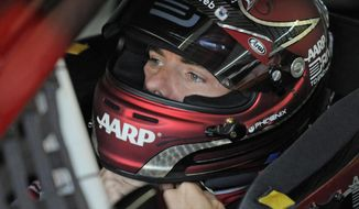 Jeff Gordon waits in his car before practice for Sunday's NASCAR Sprint Cup series Coca-Cola 600 auto race at Charlotte Motor Speedway in Concord, N.C., Saturday, May 24, 2014. (AP Photo/Mike McCarn)