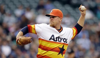 Houston Astros starting pitcher Brett Oberholtzer throws against the Seattle Mariners in the second inning of a baseball game Saturday, May 24, 2014, in Seattle. (AP Photo/Elaine Thompson)