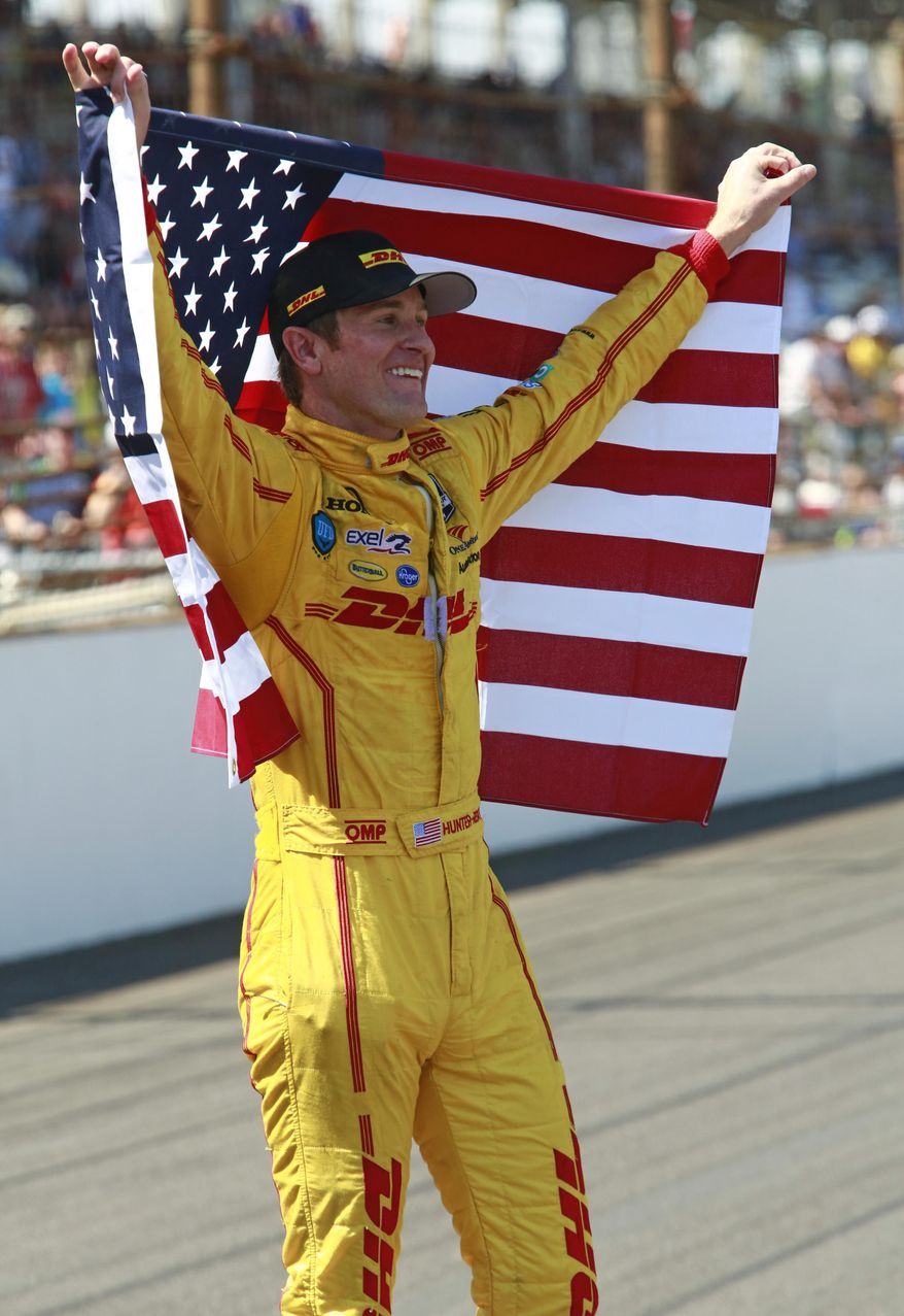 Ryan Hunter-Reay celebrates after winning the 98th running of the Indianapolis 500 IndyCar auto race at the Indianapolis Motor Speedway in Indianapolis, Sunday, May 25, 2014. (AP Photo/R Brent Smith)