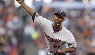 Minnesota Twins pitcher Samuel Deduno throws against the San Francisco Giants in the first inning of a baseball game Saturday, May 24, 2014, in San Francisco. (AP Photo/Tony Avelar)