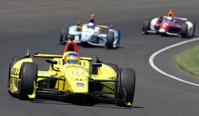 Jacques Villeneuve, of Canada, drives through the first turn during the Indianapolis 500 IndyCar auto race at the Indianapolis Motor Speedway in Indianapolis, Sunday, May 25, 2014. (AP Photo/Tom Strattman)