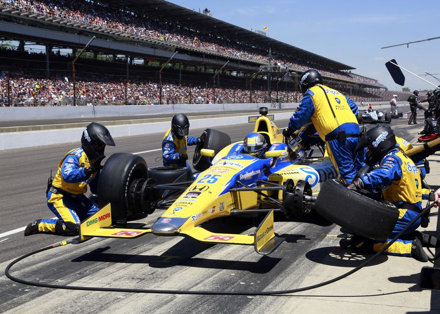 Marco Andretti pits during the 98th running of the Indianapolis 500 IndyCar auto race at the Indianapolis Motor Speedway in Indianapolis, Sunday, May 25, 2014. (AP Photo/R Brent Smith)