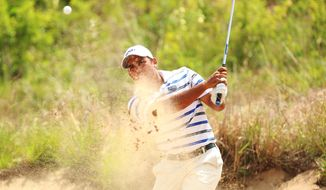 Georgia State's Davin White hits out of a green side bunker on hole 8 during the second round of the NCAA national championship Sunday, May 25, 2014 at Prairie Dunes Country Club in Hutchinson, Kan. (AP Photo/The Hutchinson News, Travis Morisse)
