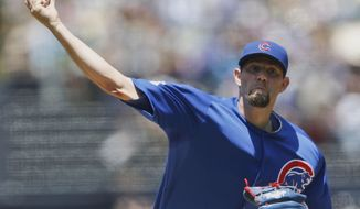 Chicago Cubs starting pitcher Jason Hammel throws against the San Diego Padres during the first inning of a baseball game Sunday, May 25, 2014, in San Diego. (AP Photo/Lenny Ignelzi)