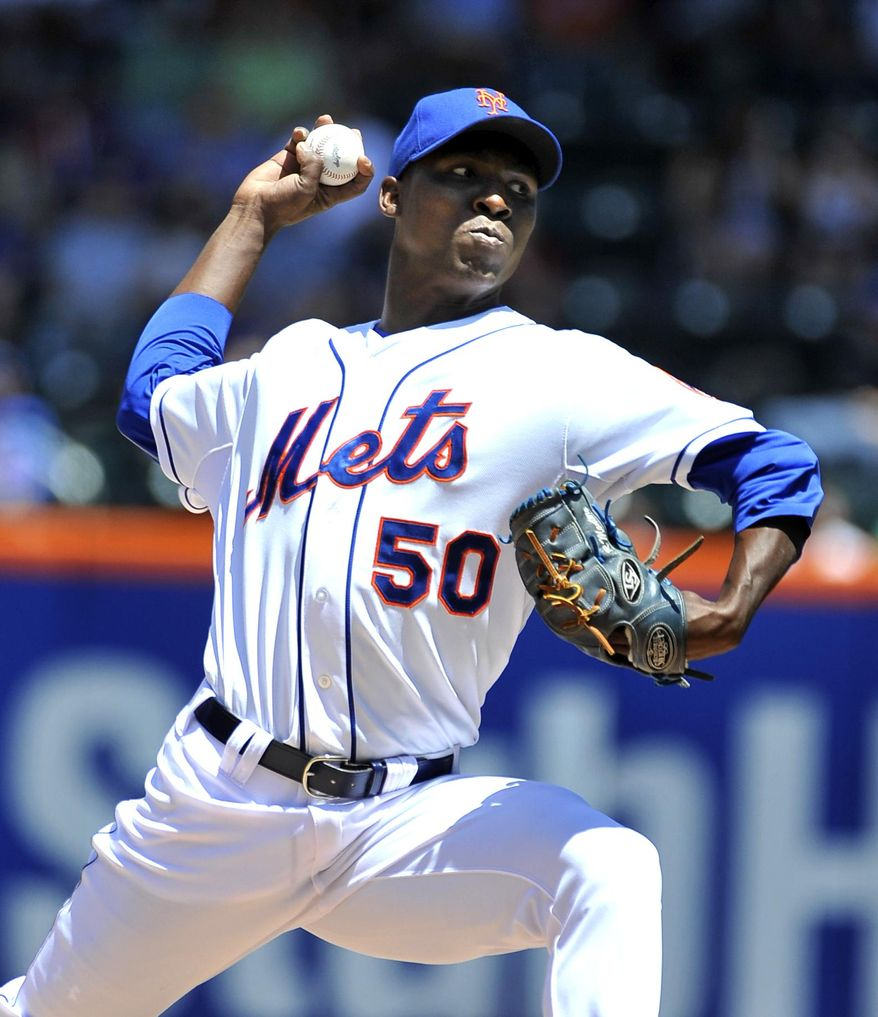 New York Mets starter Rafael Montero (50) pitches against the Arizona Diamondbacks in the first inning in game one of a doubleheader baseball game at Citi Field on Sunday, May 25, 2014, in New York. (AP Photo/Kathy Kmonicek)