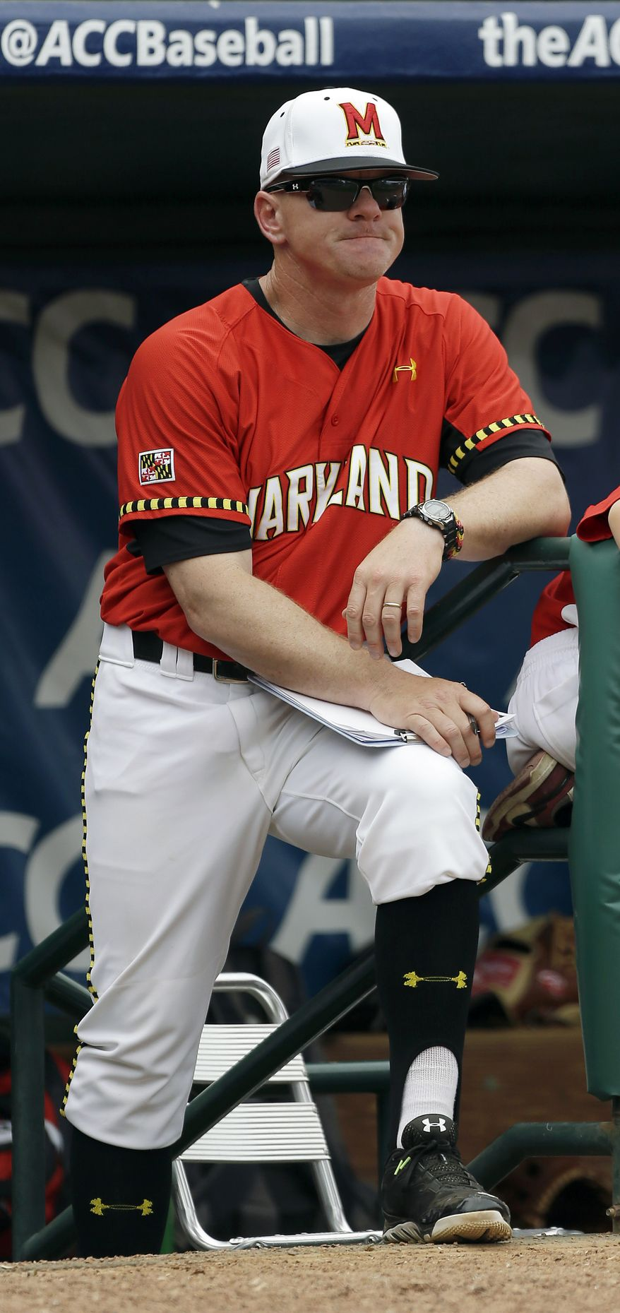Maryland head coach John Szefc  watches the action against Georgia Tech from the dugout in the fifth inning during the championship game of the Atlantic Coast Conference baseball tournament in Greensboro, N.C., Sunday, May 25, 2014. Georgia Tech won 9-4. (AP Photo/Bob Leverone)