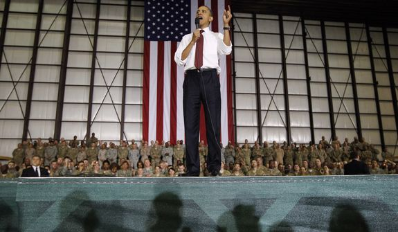 FILE - This May 2, 2012 file photo shows President Barack Obama addressing troops at Bagram Air Field, Afghanistan. President Obama has made a surprise trip to Afghanistan for a Memorial Day weekend visit with U.S. troops serving in America's longest war.(AP Photo/Charles Dharapak)