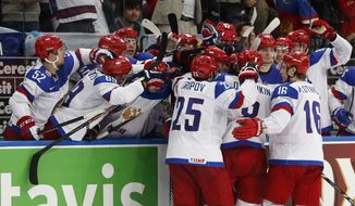 Alex Ovechkin and other Russia players celebrate after scoring a goal during the gold medal match against Finland at the Ice Hockey World Championship in Minsk, Belarus, Sunday, May 25, 2014. (AP Photo/Darko Bandic)