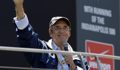 "Jim Nabors waves to fans after singing ""(Back Home Again in) Indiana"" for the final time before the start of the 98th running of the Indianapolis 500 IndyCar auto race at the Indianapolis Motor Speedway in Indianapolis, Sunday, May 25, 2014. (AP Photo/Michael Conroy)"