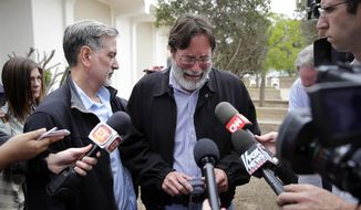 Richard Martinez, center, who says his son Christopher Martinez was killed in Friday night's mass shooting that took place in Isla Vista, Calif., is comforted by his brother, Alan, as he talks to media outside the Santa Barbara County Sheriff's Headquarters on Saturday, May 24, 2014, in Santa Barbara, Calif. (AP Photo/Jae C. Hong)