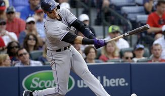 Colorado Rockies' Troy Tulowitzki singles in the eighth inning of a baseball game against the Atlanta Braves, Saturday, May 24, 2014, in Atlanta. (AP Photo/David Goldman)