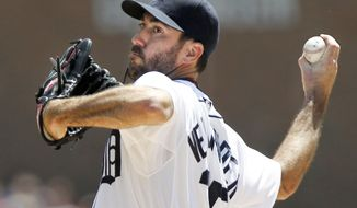 Detroit Tigers pitcher Justin Verlander delivers against the Texas Rangers in the first inning of a baseball game on Sunday, May 25, 2014, in Detroit. (AP Photo/Duane Burleson)