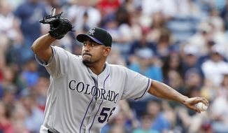 Colorado Rockies starting pitcher Franklin Morales (56) works in the first inning of a baseball game against the Atlanta Braves Sunday, May 25, 2014 in Atlanta. (AP Photo/John Bazemore)