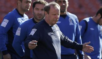 Azerbaijan soccer head coach Berti Vogts, center, gathers his team together before practice at Candlestick Park in San Francisco, Sunday, May 25, 2014. (AP Photo/Jeff Chiu)