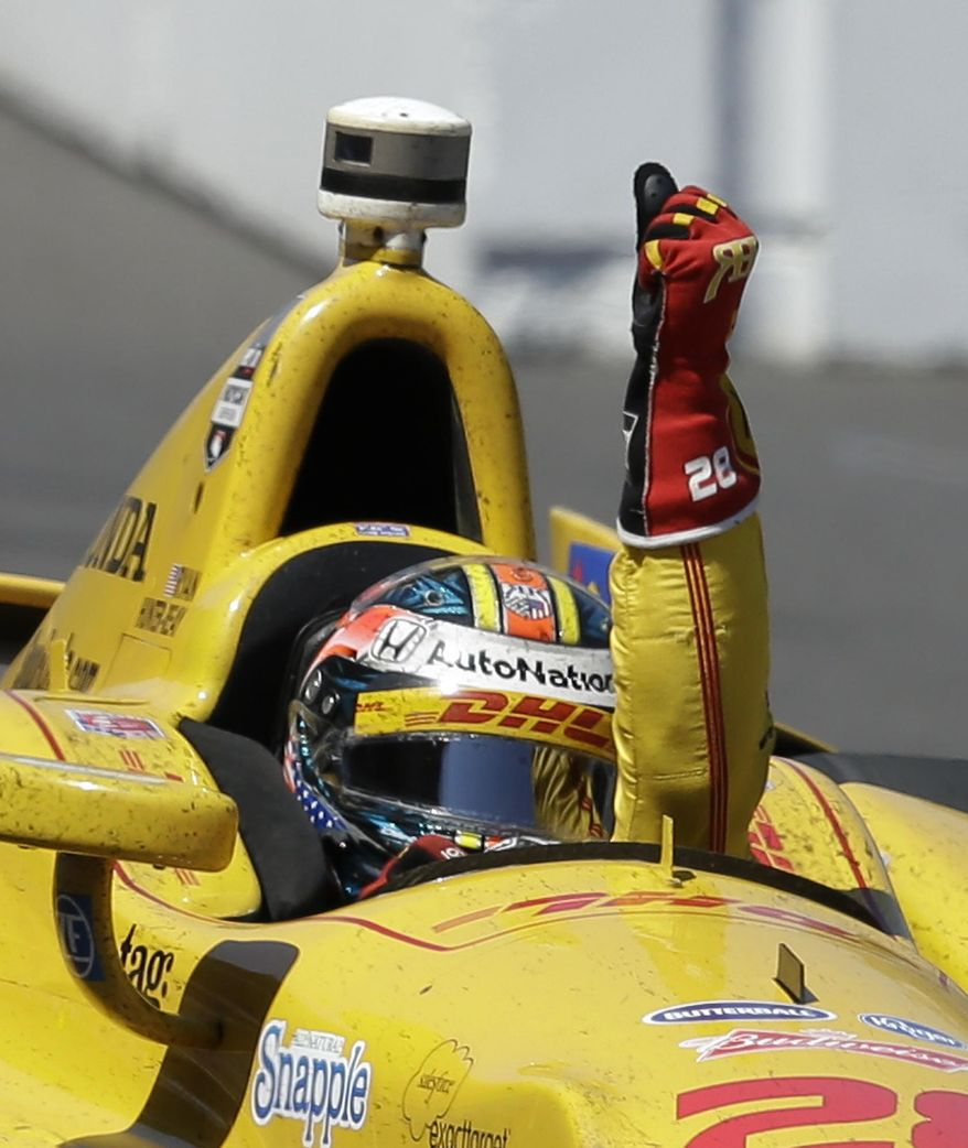 Ryan Hunter-Reay celebrates after winning the Indianapolis 500 IndyCar auto race at the Indianapolis Motor Speedway in Indianapolis, Sunday, May 25, 2014. (AP Photo/Darron Cummings)