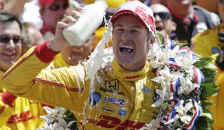 Ryan Hunter-Reay celebrates winning the Indianapolis 500 IndyCar auto race at the Indianapolis Motor Speedway in Indianapolis, Sunday, May 25, 2014. (AP Photo/AJ Mast)