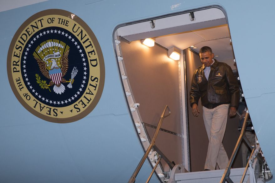 President Barack Obama steps off Air Force One after arriving at Bagram Air Field for an unannounced visit, on Sunday, May 25, 2014, north of Kabul, Afghanistan. (AP Photo/ Evan Vucci)