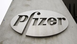 In this May 4, 2014 photo, the Pfizer logo is displayed on the exterior of a former Pfizer factory  in the Brooklyn borough of New York. Pfizer says it does not intend to make a takeover offer for British drugmaker AstraZeneca. The Monday, May 26, 2014 announcement comes a week after AstraZeneca's board rejected a proposed $119 billion buyout offer from Pfizer, the world's second-biggest drugmaker by revenue. (AP Photo/Mark Lennihan, File)