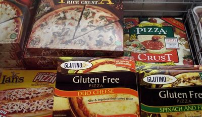 **FILE** This photo from Nov. 11, 2008, shows gluten-free frozen pizza, one of hundreds of items at Gluten Free Trading Co. in Milwaukee. (Associated Press)