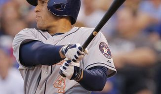 Houston Astros right fielder George Springer hits a two-run double off Kansas City Royals starting pitcher Yordano Ventura during the second inning of a baseball game at Kauffman Stadium in Kansas City, Mo., Monday, May 26, 2014. (AP Photo/Orlin Wagner)