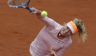 Russia's Maria Sharapova serves to compatriot Russia's Ksenia Pervak during the first round match of  the French Open tennis tournament at the Roland Garros stadium, in Paris, France, Monday, May 26, 2014. (AP Photo/Michel Euler)