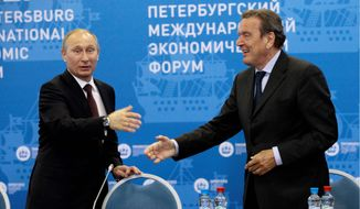 Russian President Vladimir Putin, left, and Germany's former Chancellor Gerhard Schroeder attend an economic forum in St.Petersburg, Russia, Thursday, June 21, 2012. (AP Photo/Dmitry Lovetsky, pool)