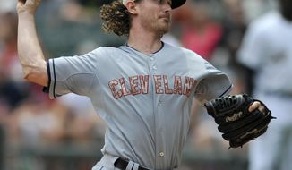 Cleveland Indians starter Josh Tomlin delivers a pitch during the first inning of a baseball game against the Chicago White Sox in Chicago, Monday, May 26, 2014. (AP Photo/Paul Beaty)