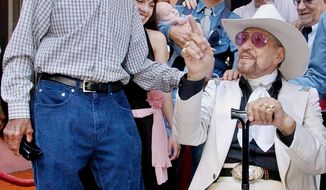 FILE - In this Friday, Sept. 24, 2004 photo, Herb Jeffries, a singing cowboy hero of the silver screen, right, is congratulated by jazz great Gerald Wilson following dedication ceremonies for Jeffries' star on the Walk of Fame in the Hollywood section of Los Angeles, on his 93rd birthday.  Herb Jeffries, the first African-American singing cowboy to appear in movies in the 1930s, died of heart failure Sunday, May 25, 2014, at a Los Angeles hospital. He was 100.  (AP Photo/Reed Saxon, File)