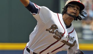 Atlanta Braves' Ervin Santana (30) pitches against the Boston Red Sox during the first inning of a baseball game on Monday, May 26, 2014, in Atlanta, Ga. (AP Photo/Butch Dill)