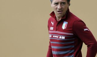 Italy coach Cesare Prandelli arrives for a team training session at Coverciano training grounds, in Florence, Monday, May 26, 2014. In Brazil, Italy is in Group D with England, Uruguay and Costa Rica. (AP Photo/Fabrizio Giovannozzi)