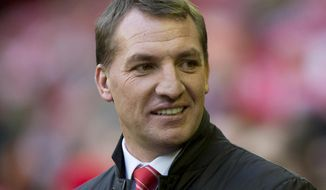 FILE - This is a Sunday Feb. 23, 2014 file photo of Liverpool's manager Brendan Rodgers as he smiles prior to his team's English Premier League soccer match against Swansea City at Anfield Stadium, Liverpool, England.  It was reported Monday May 26, 2014 that Liverpool manager Brendan Rodgers has signed a new long-term contract with the Premier League club,  a reward for reviving the fortunes of one of England's biggest teams. (AP Photo/Jon Super, File)