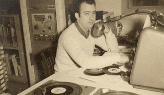 This undated photo provided by Mid-South Community College in West Memphis, Ark. shows Eddie Bond at the microphone at radio station KWEM. The station, now owned by the college, that began broadcasting in West Memphis in 1947 and lasted until 1960 is being re-launched this week on the Internet. Plans are for a return to the air as an FM broadcast in August 2014. (AP Photo/Mid-South Community College)