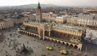 In this photo taken on Nov. 3, 2004, is seen the Cloth Market in the Renaissance Market Square in the historic city of Krakow, Poland. The city mayor, Jacek Majchrowski, on Monday cancelled its bid for the 2022 Winter Games after residents overwhelmingly voted against in a local referendum held on Sunday, May 25, 2014. (AP Photo/Czarek Sokolowski, File)