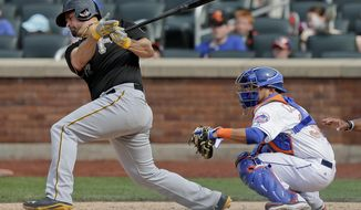 Pittsburgh Pirates first baseman Gaby Sanchez (17) follows through on a base hit that scored Neil Walker and Andrew McCutchen during the ninth inning of a baseball game, Monday, May 26, 2014, in New York. The Pirates won 5-3. (AP Photo/Julie Jacobson)