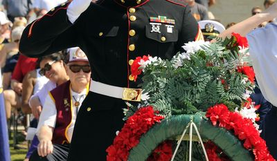 U.S. Marine Sgt. Andre Charles salutes during the annual Memorial Day Ceremony at the Alabama National Cemetery in Montevallo, Ala., Monday, May 26, 2014. (AP Photo/AL.com, Joe Songer) MAGS OUT