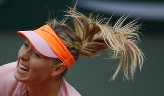 Russia's Maria Sharapova serves the ball to compatriot Ksenia Pervak during their first round match of  the French Open tennis tournament at the Roland Garros stadium, in Paris, France, Monday, May 26, 2014. Sharapova won 6-1, 6-2.  (AP Photo/Michel Euler)
