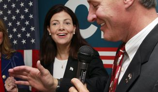 U.S. Sen. Kelly Ayotte laughs after U.S. Senate candidate Scott Brown comments on her endorsement  Tuesday, May 27, 2014, in Nashua, N.H. Ayotte endorsed Brown as the campaign tries to unseat U.S. Sen. Jeanne Shaheen, D-N.H.(AP Photo/Jim Cole)