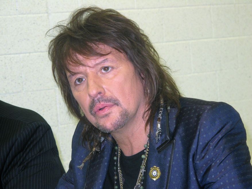 """Bon Jovi guitarist Richie Sambora speaks to reporters in Toms River N,.J. before a performance at an anti-drug forum on May 27, 2014. Sambora unveiled a new song, """"Lighthouse"""" that will raise money for a drug treatment center in New Jersey.(AP Photo/Wayne Parry)"""