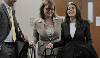 FILE- In this April 10, 2013 file photo, Fox television reporter Jana Winter, right, and her attorneys arrive at district court for a hearing for Aurora theater shooting suspect James Holmes in Centennial, Colo. The U.S. Supreme Court said Tuesday, May 27, 2014 that Winter does not have to reveal her confidential sources for a story about Holmes. (AP Photo/Ed Andrieski, File)