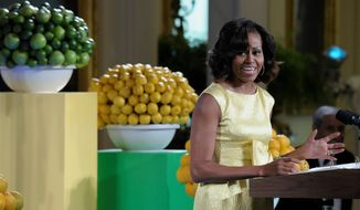 """First lady Michelle Obama speaks at the second annual White House """"Kids' State Dinner"""" in the East Room of the White House in Washington, Tuesday, July 9, 2013. Obama welcomed 54 children to the White House for creating winning recipes as part of a healthy lunch contest. (AP Photo/Susan Walsh)"""