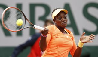 Sloane Stephens, of the U.S, returns the ball to China's Peng Shuai during the first round match of  the French Open tennis tournament at the Roland Garros stadium, in Paris, France, Tuesday, May 27, 2014. (AP Photo/Darko Vojinovic)