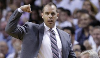 Indiana Pacers head coach Frank Vogel gestures during the first half of Game 4 in the NBA basketball Eastern Conference finals playoff series against the Miami Heat, Monday, May 26, 2014, in Miami. (AP Photo/Wilfredo Lee)