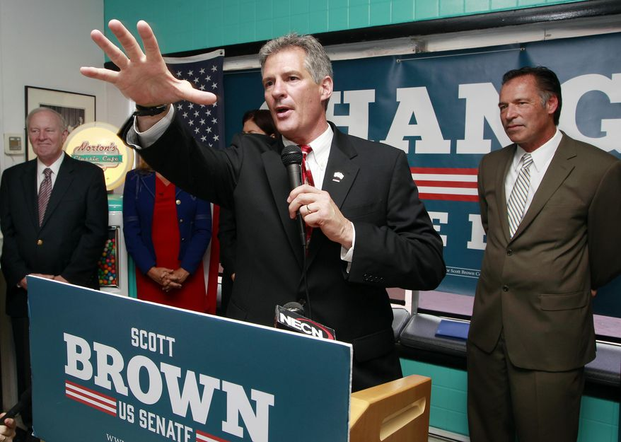 **FILE** U.S. Senate candidate Scott Brown, New Hampshire Republican, speaks after getting the endorsement from former New Hampshire Govs. Steve Merrill (far left) and Craig Benson (far right) and U.S. Sen. Kelly Ayotte (not seen) in Nashua, N.H., on May 27, 2014. Brown is trying to unseat Democratic Sen. Jeanne Shaheen. (Associated Press)
