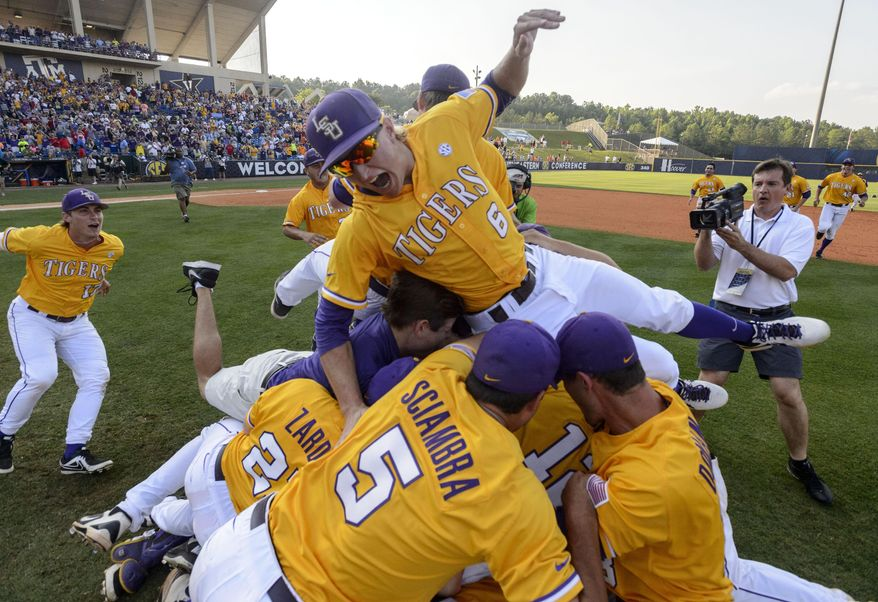 LSU piles up on the field and celebrates after winning the SEC Baseball Tournament championship game 2-0 over Florida, Sunday, May 25, 2014, at the Hoover Met in Hoover, Ala. (AP Photo/AL.com, Vasha Hunt ) MAGS OUT