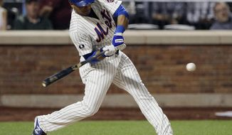 New York Mets' Juan Lagares hits an RBI double during the fourth inning of a baseball game against the Pittsburgh Pirates on Tuesday, May 27, 2014, in New York.  (AP Photo/Frank Franklin II)