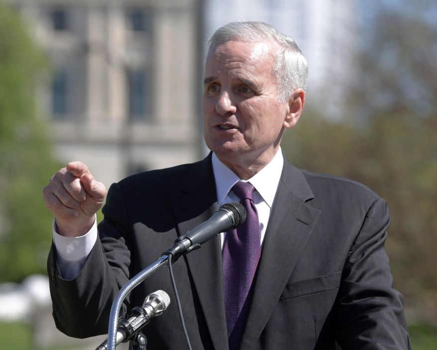 """FILE - In this May 22, 2014 file photo Minnesota Gov. Mark Dayton speaks at the Minnesota State Capitol in St. Paul. Minn. Dayton said on Tuesday, May 27, 2014  Minnesotans will find life simpler after a so-called """"Unsession"""" that wiped more than 1,000 outdated laws off the books. (AP Photo/Jim Mone, File)"""
