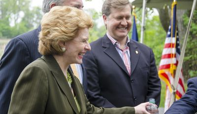 U.S. Sen. Debbie Stabenow laughs before beginning an interview following a press conference at the Bay City State Recreation Area in Bangor Township on Tuesday, May 27 2014. The U.S. Department of Agriculture is teaming with businesses, nonprofits and others on a five-year, $2.4 billion program that will fund locally designed soil and water conservation projects nationwide, Agriculture Secretary Tom Vilsack said.  Stabenow was primary writer of the farm bill with Rep. Frank Lucas of Oklahoma.  (AP Photo/The Bay City Times, Danielle McGrew)