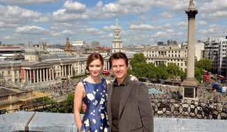 Actors Emily Blunt and Tom Cruise at a photocall for their new film Edge of Tomorrow, where a part is being filmed in Trafalgar Square, background,  in London, Sunday, May 25, 2014.  Nelson's Column is at right, the National Gallery is at left,  (AP Photo / John Stillwell/PA) UNITED KINGDOM OUT