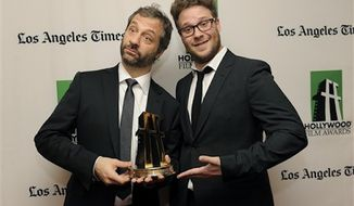 Judd Apatow, left, recipient of the Hollywood Comedy Award, poses with actor Seth Rogen backstage at the 16th Annual Hollywood Film Awards Gala on Monday, Oct. 22, 2012, in Beverly Hills, Calif. (Photo by Chris Pizzello/Invision/AP) ** FILE **
