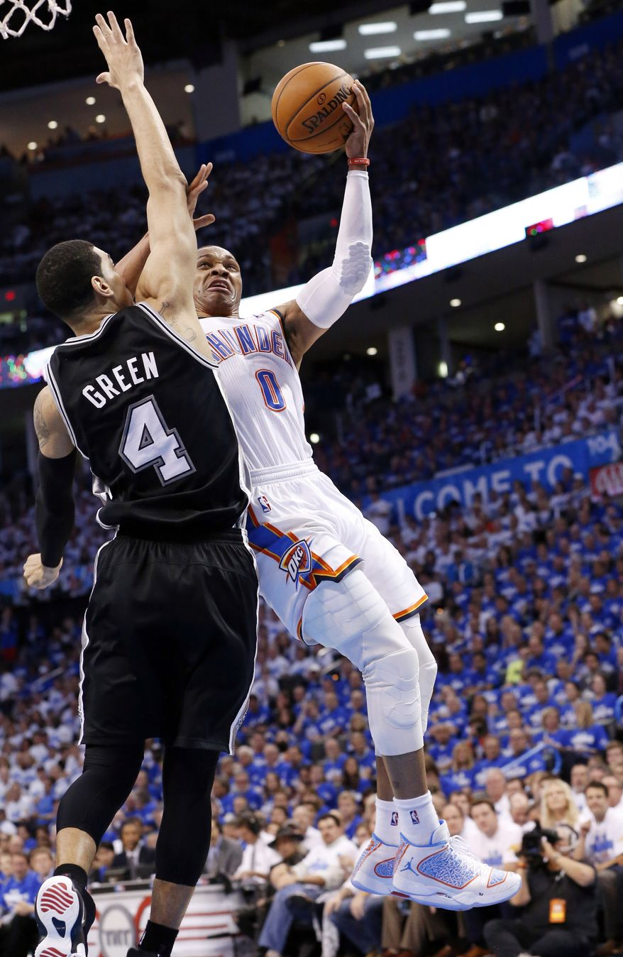 Oklahoma City Thunder guard Russell Westbrook (0) shoots in front of San Antonio Spurs guard Danny Green (4) in the second quarter of Game 4 of the Western Conference finals NBA basketball playoff series in Oklahoma City, Tuesday, May 27, 2014. (AP Photo/Sue Ogrocki)